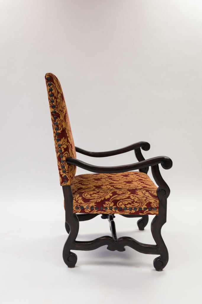 Single red upholstery chair before