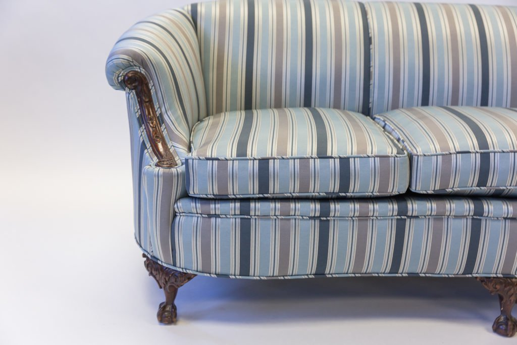 Upholstered coach half stripped fabric