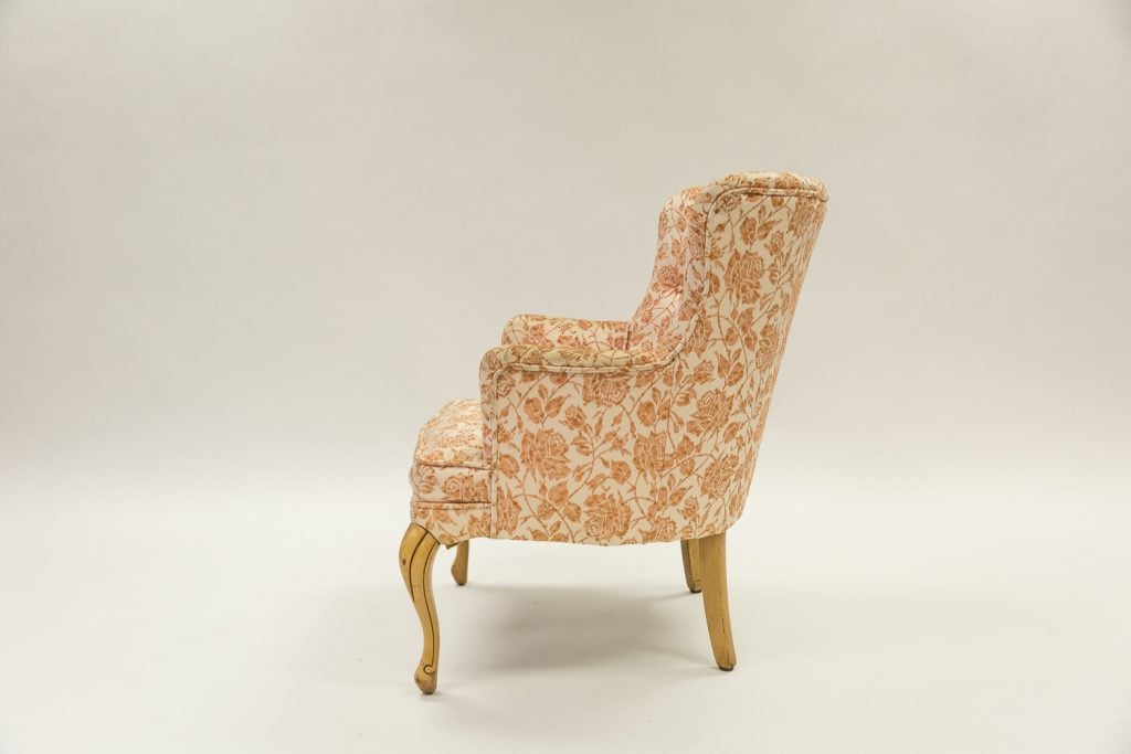 Floral chair before upholstery side view