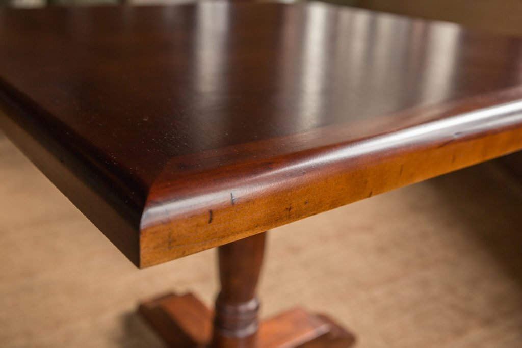 Closeup of brown table after restoration