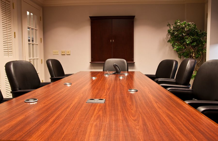 Veneer Conference Table: Back to Life Through Refinishing